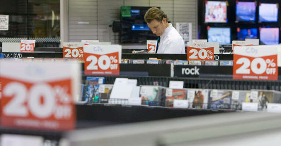 Allen Swift, shopping at Circuit City for DVDs, said he wasn't impressed by the price of new movies at the electronic chain's going-out-of-business sale. Photo: Steve Campbell, Houston Chronicle