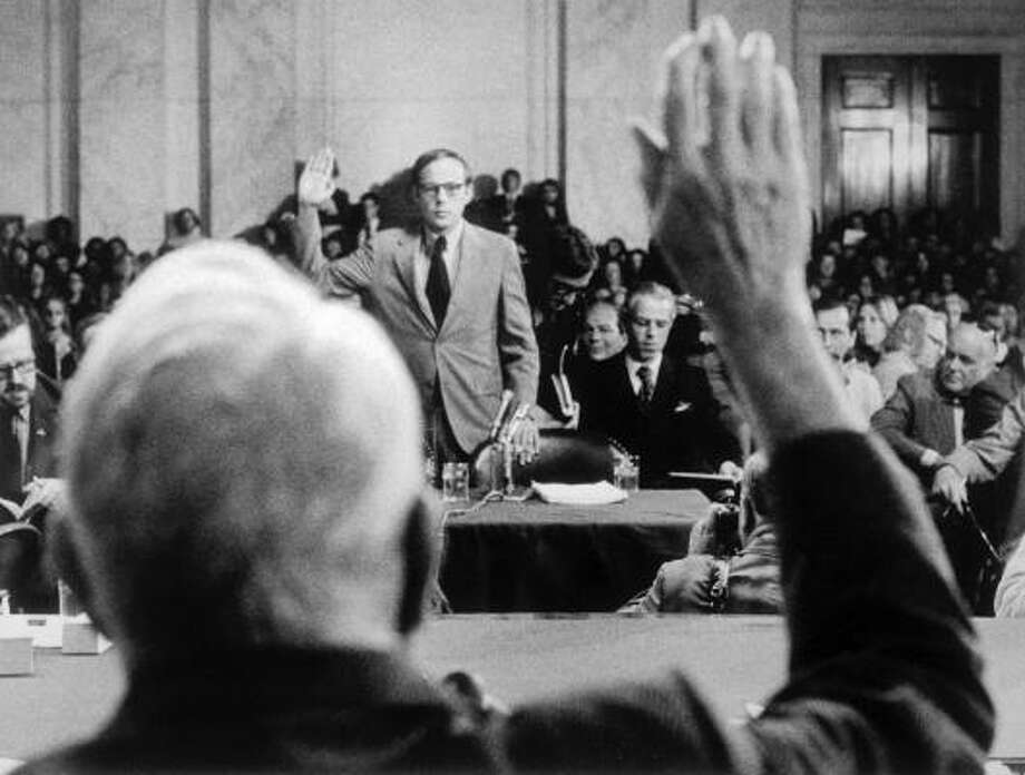 John Dean is sworn in by Sen. Sam Ervin, D-N.C., as the former White House counsel appears before the Senate Watergate Committee on June 25, 1973. Photo: Associated Press File