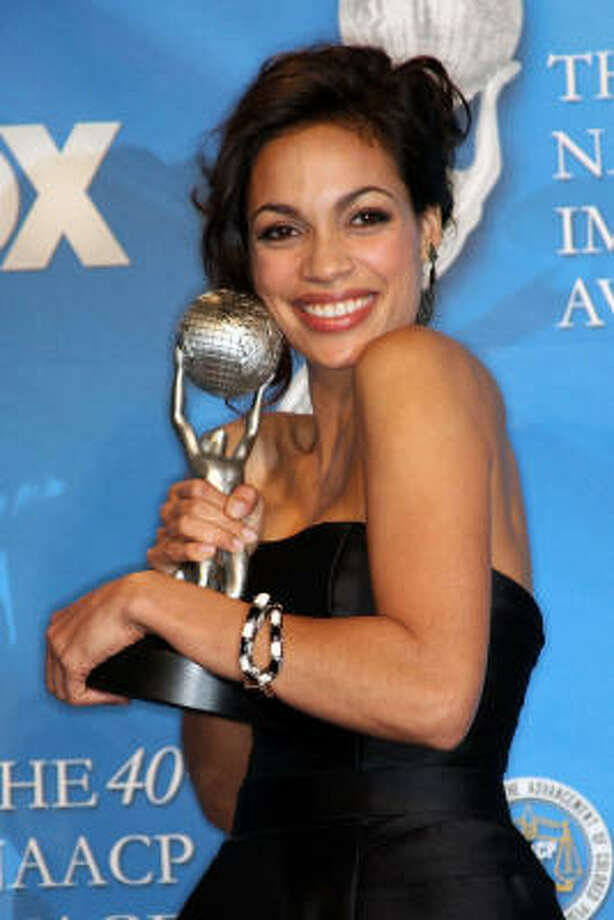 "Actress Rosario Dawson poses with her award for Outstanding Actress in a Motion Picture for ""Seven Pounds"" in the press room during the 40th NAACP Image Awards held at the Shrine Auditorium in Los Angeles. Photo: Frederick M. Brown, Getty Images For NAACP"