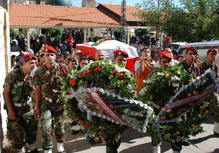 Lebanese soldiers carry the coffin of their colleague Mahdi Mohammed al-Mazbouh, who died during clashes with the Fatah Islam militants in the Nahr el-Bared camp on the northern port city of Tripoli on Sunday. Photo: SAMER HUSSEINI, AP