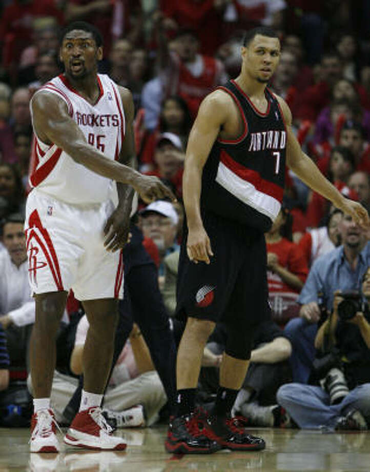 Trail Blazers guard Brandon Roy, left, standing opposite Rockets forward Ron Artest, scored 31 points and had five rebounds, five assists and three steals in Game 4. Photo: Brett Coomer, Chronicle