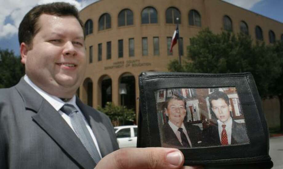 """Trustee Michael Wolfe, who carries a picture of him with President Reagan in his wallet, suggested the name change to the Harris County Department of Education. """"He has always been a hero of mine."""" Photo: STEVE UECKERT, CHRONICLE"""