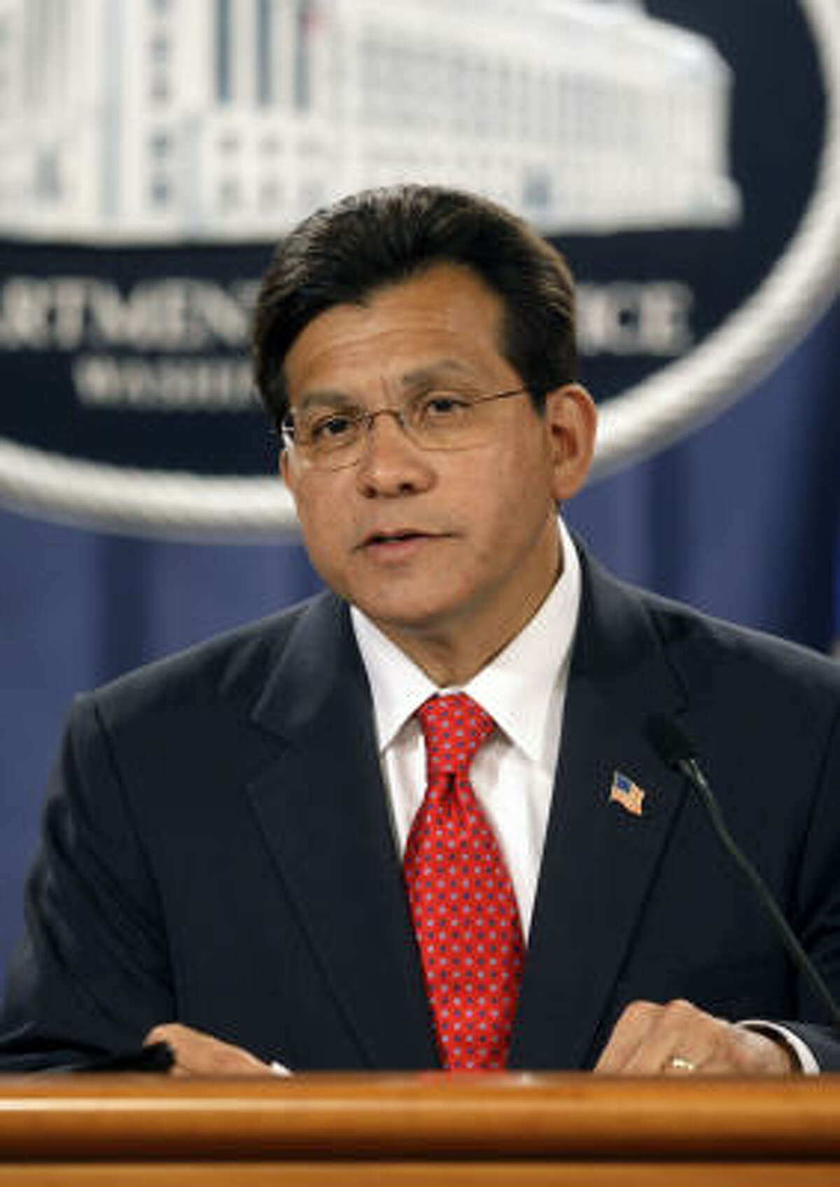 Attorney General Alberto Gonzales announces his resignation during at a news conference at the Department of Justice in Washington.