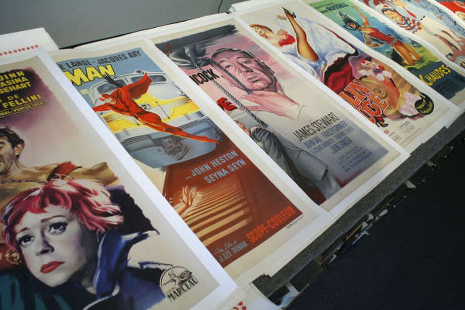 Oversize film posters from around the world are a large part of Retro Gallery's business. The gallery sells original advertising posters as art. Photo: Steve Ueckert, Houston Chronicle