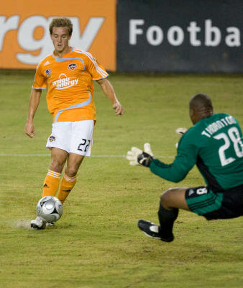Dynamo midfielder Stuart Holden kicks a goal past Chivas USA goalkeeper Zach Thornton in the first half on Wednesday at Robertson Stadium. Photo: Steve Campbell, Chronicle