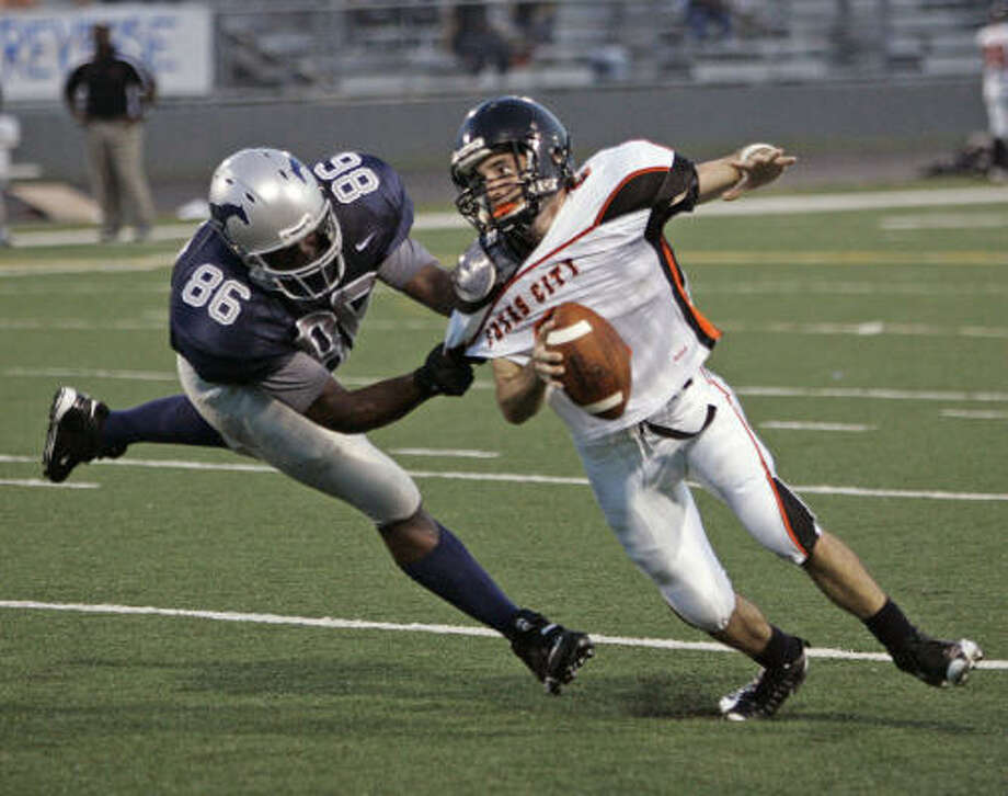 Lamar Consolidated's D'Vonn Brown makes life difficult for Texas City QB Cody Hernandez in the second quarter. The Mustangs jumped out to a 14-0 first quarter lead on two D.J. Smallwood touchdown runs. Photo: Craig Hartley, For The Chronicle