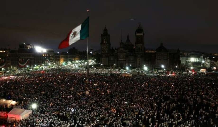 Thousands of people light candles at the main Zocalo square in Mexico City during a protest Saturday against a wave of violent crimes sweeping the country. Marches were planned in all 32 Mexican states. Photo: MARCO UGARTE, ASSOCIATED PRESS