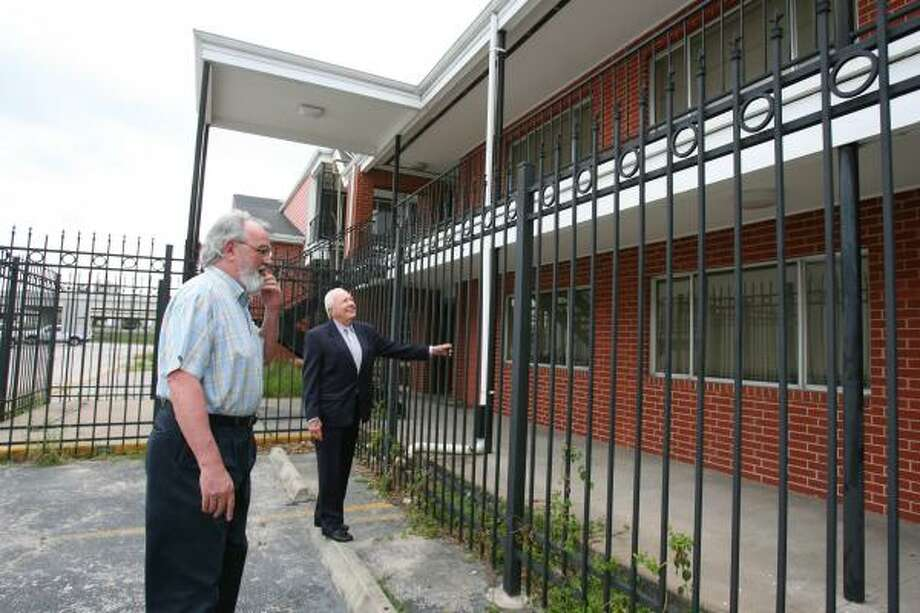 Earl Hatcher, left, and Tom Lord of the Housing Corporation of Greater Houston visit Magnolia Glen in July. Photo: SHARÓN STEINMANN, CHRONICLE FILE