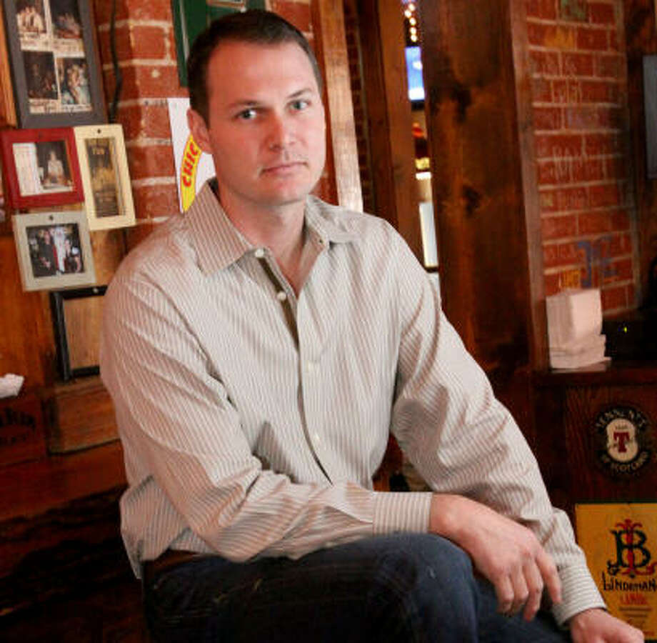 """Front Porch Pub co-owner Josh Harris says his bar is """"definitely feeling"""" a downturn in business. Photo: Bill Olive, For The Chronicle"""