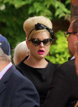 Kelly Osbourne, center, arrives at Golders Green Crematorium for the funeral ceremony of British singer Amy Winehouse, north London, Tuesday, July 26, 2011. Winehouse, who had battled alcohol and drug addiction, was found dead Saturday at her London home. She was 27. (AP Photo/Joel Ryan) Photo: Joel Ryan / AP