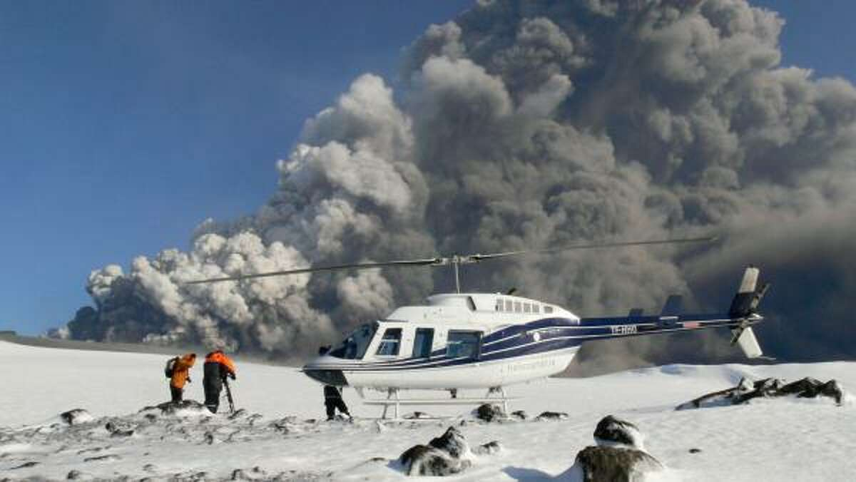 A film crew working for National Geographic sets up Sunday on southern Iceland's Eyjafjallajokull glacier. Scientists say that because the volcano is situated below the glacial ice cap, magma is being cooled quickly, causing explosions and plumes of grit.