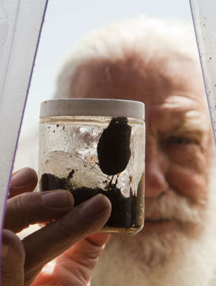 Scientist Tony Amos collected this sample of oil from the Ixtoc 1 spill in 1979. Photo: Smiley N. Pool, Chronicle