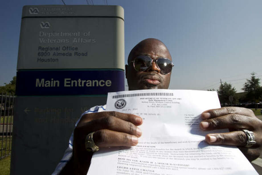 "John Paul Scott, a disabled Gulf War veteran, shows a letter he received from the VA stating that he was deceased and billing his ""estate"" for repayment of benefits. Photo: Nick De La Torre, Chronicle"