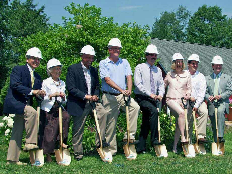 SPECTRUM/Handling the ceremonial groundbreaking for the expansion project at the High Watch Recovery Center in Kent are, from left to right, Dr. Arcuni, the center's director of addiction medicine; interior designer Marilyn Cosgrove; John Petronella of Enfield Builders; Kent First Selectman Bruce Adams; Al Jacunski of Jacunski Humes Architects;Janina Kean, the High Watch president and CEO; Vinny Roberti, the center's director of maintenance; and State Sen. Andrew Roraback (R-30th). Photo: Trish Haldin