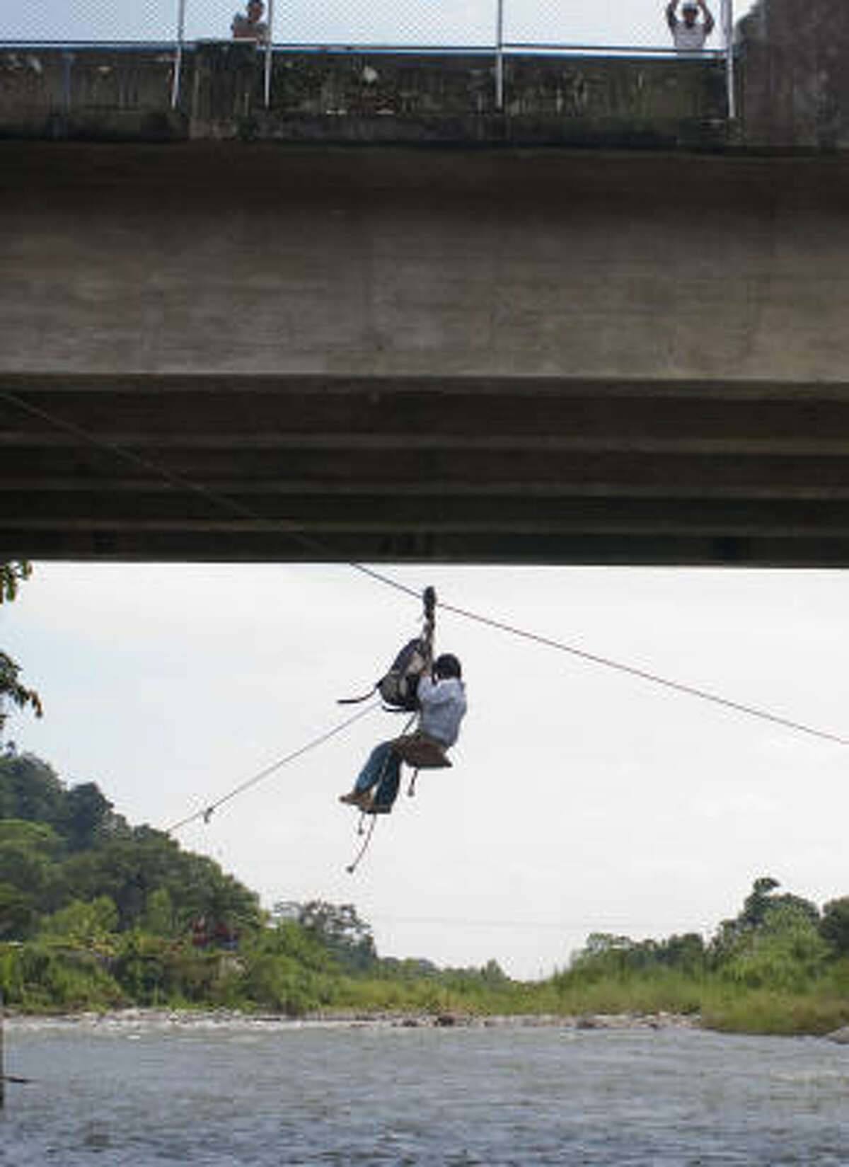 It's a zip for some migrants to cross from Guatemala to Mexico. After the rope ride under the international bridge and over the Suchiate River, though, far greater perils await.