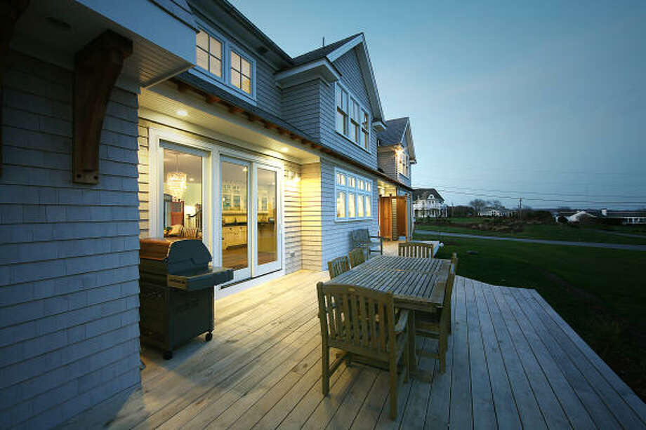 """Kimberly and Joe Hageman used primarily LED lights in their green dream house in Narragansett, R.I. They chronicled the 2009 project in a blog called """"Green Life Smart Life."""" Photo: Ashley Daigneault/Caster Communi"""