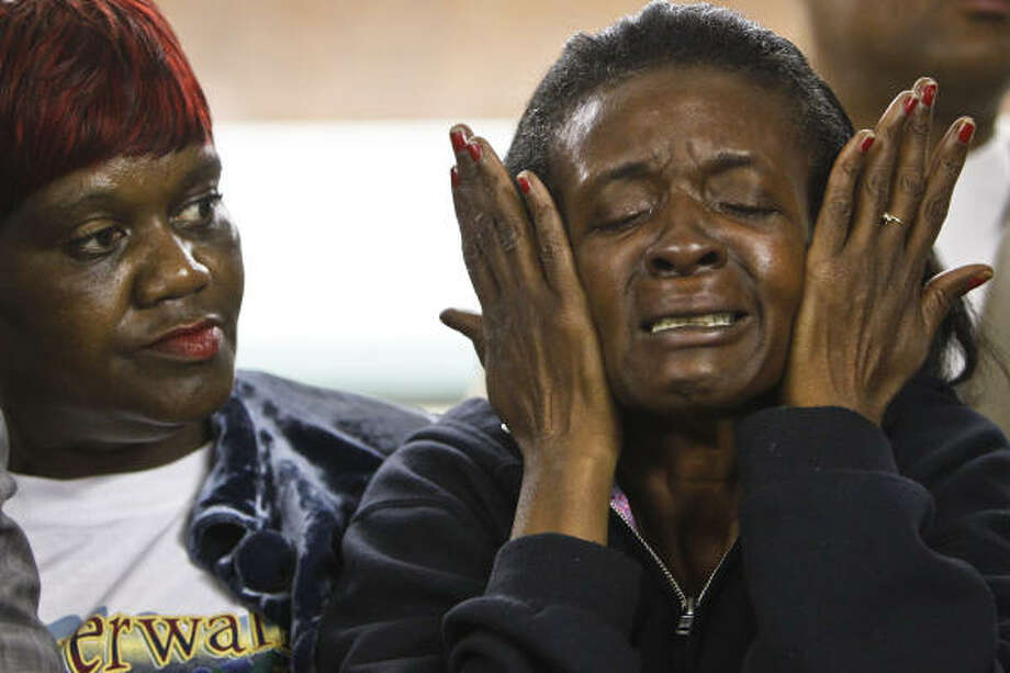 Anita Ellis wipes away tears as she and Daphne Straughter listen to Houston community activist Quanell X, who held a rally in Cleveland where he requested funds for lawyers for suspects in the gang rape of an 11-year-old girl. Ellis said her son, Timothy Ellis, was one of the first men to turn himself in to police. Photo: Michael Paulsen, Chronicle