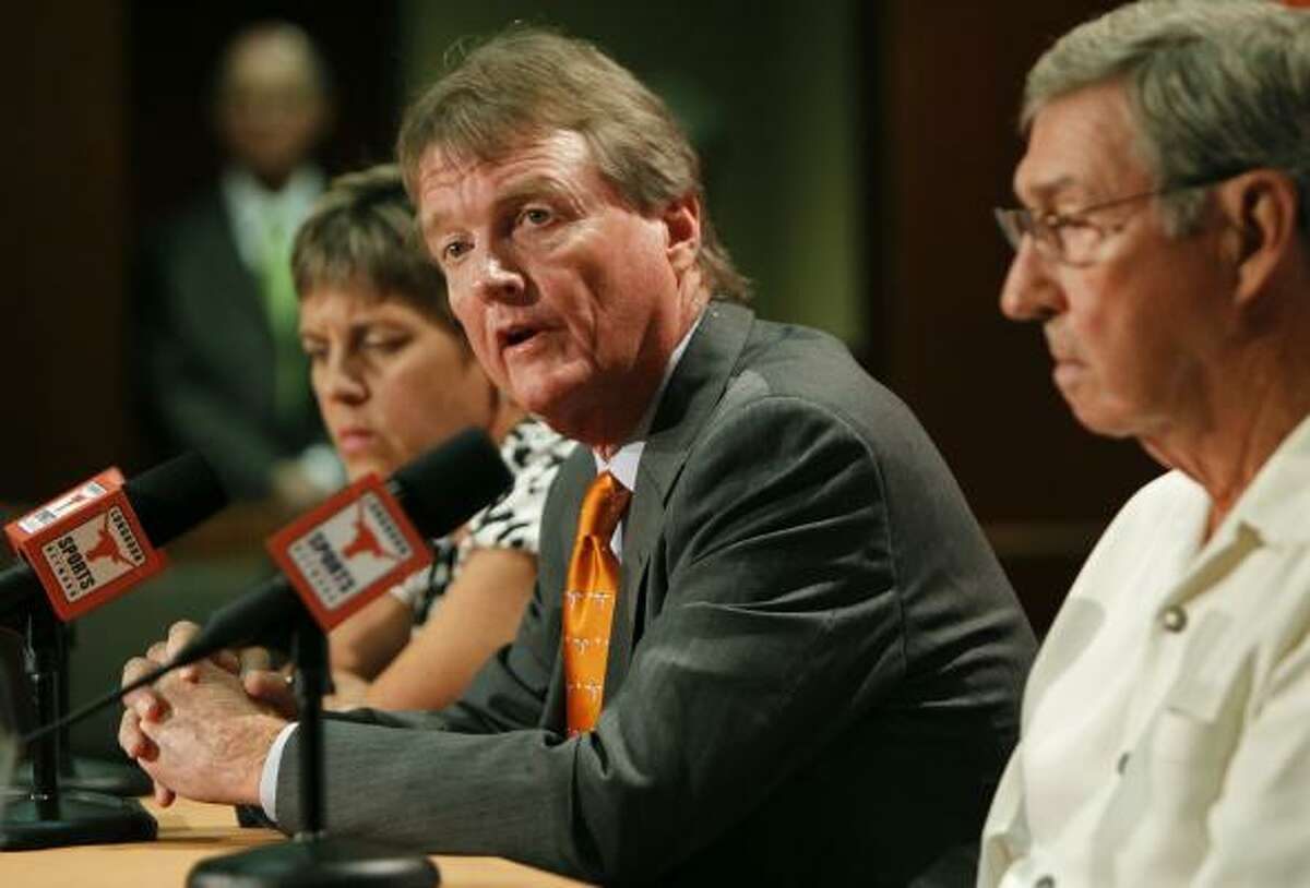 """UT president William Powers, center, said Tuesday that the Longhorns are """"in a far better position now."""""""