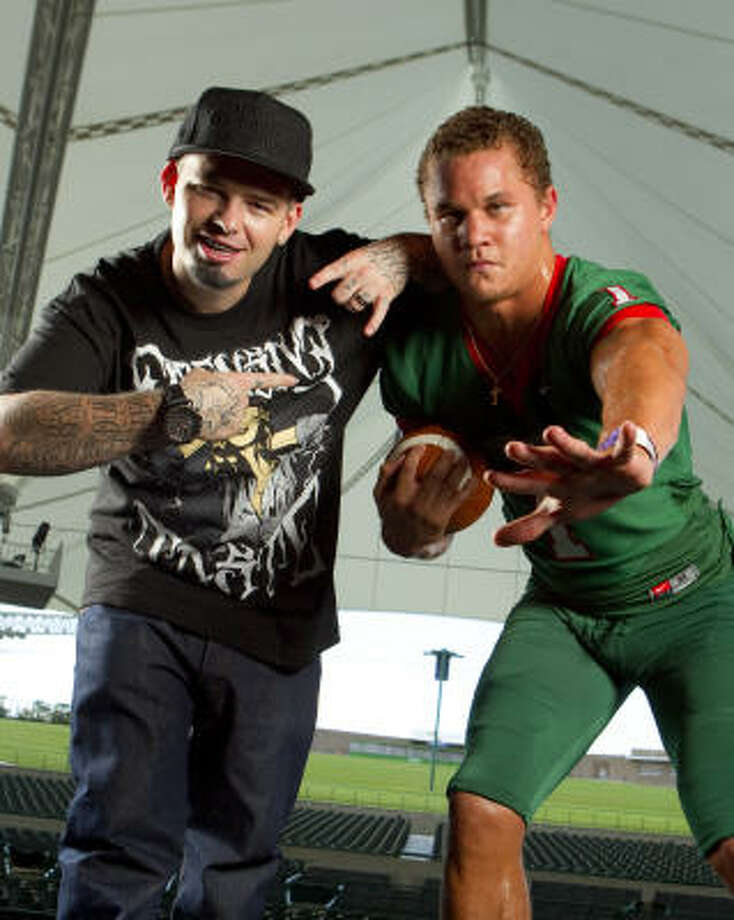 Paul Wall and The Woodlands  running back Daniel Lasco both do their best to 'represent' Texas. Photo: Brett Coomer, Chronicle