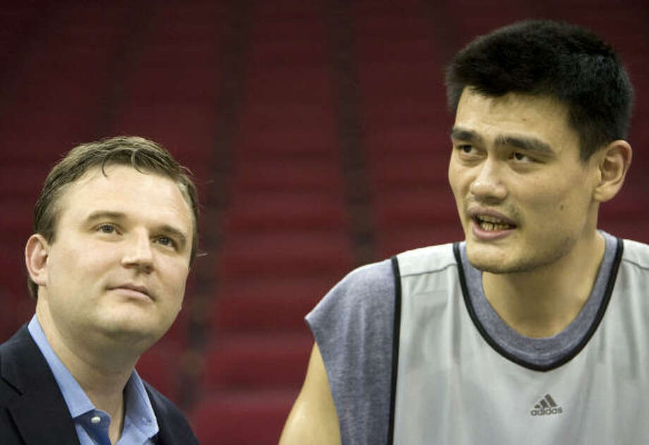 The plans general manager Daryl Morey, left, has for the Rockets depend on his injured center, Yao Ming. Photo: James Nielsen, Chronicle