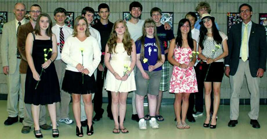 SPECTRUM/Thirteen students at Shepaug Valley High School in Washington were recently inducted into the school's Tri-M Music Honor Society. Among those on hand for the June 11 ceremony were, from left to right, front row, Amanda Taylor, Katherine Tracy, Grace Kellogg, Sarah Irwin, Adrienne Fedyna-Dembeck and Callie Huber, as well as faculty member and Tri M advisor Friso Hermans; back row, faculty members Christopher Shay and Kevin Klepacki, plus inductees Gregory Valentine, Oliver Taylor, Andrew Stern, Jesse Steinmetz, Matthew Dever, Nathan Ong and Jozef Lepelley.  Courtesy of Taylor Weston Photo: Contributed Photo