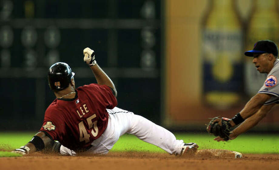 Carlos Lee slides into second trying to stretch a hit into a double during the sixth inning. He was called out. Photo: Eric Kayne, Chronicle