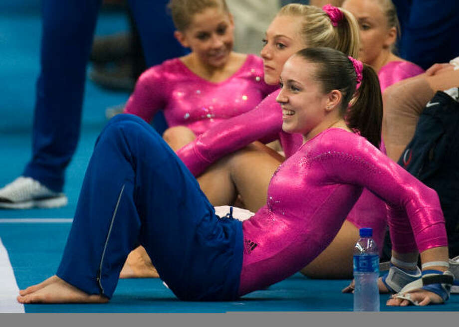 U.S. gymnast Chellsie Memmel smiles while stretching with teammates during official training at the National Indoor Stadium in preparation for the 2008 Summer Olympic Games on Thursday in Beijing. Photo: Smiley N. Pool, Chronicle