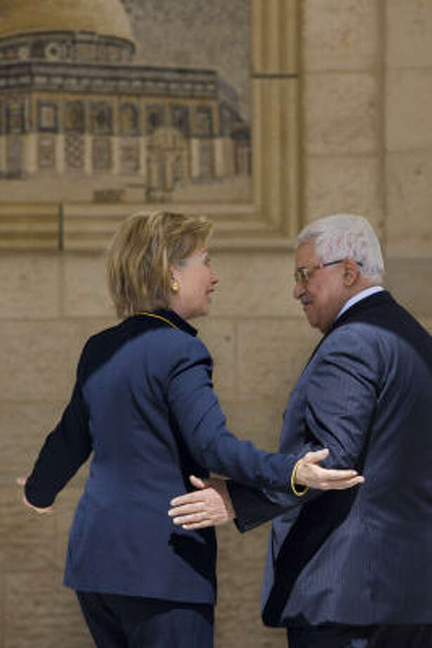 Secretary of State Hillary Rodham Clinton and Palestinian President Mahmoud Abbas meet in the West Bank town of Ramallah. Photo: Bernat Armngue, Associated Press