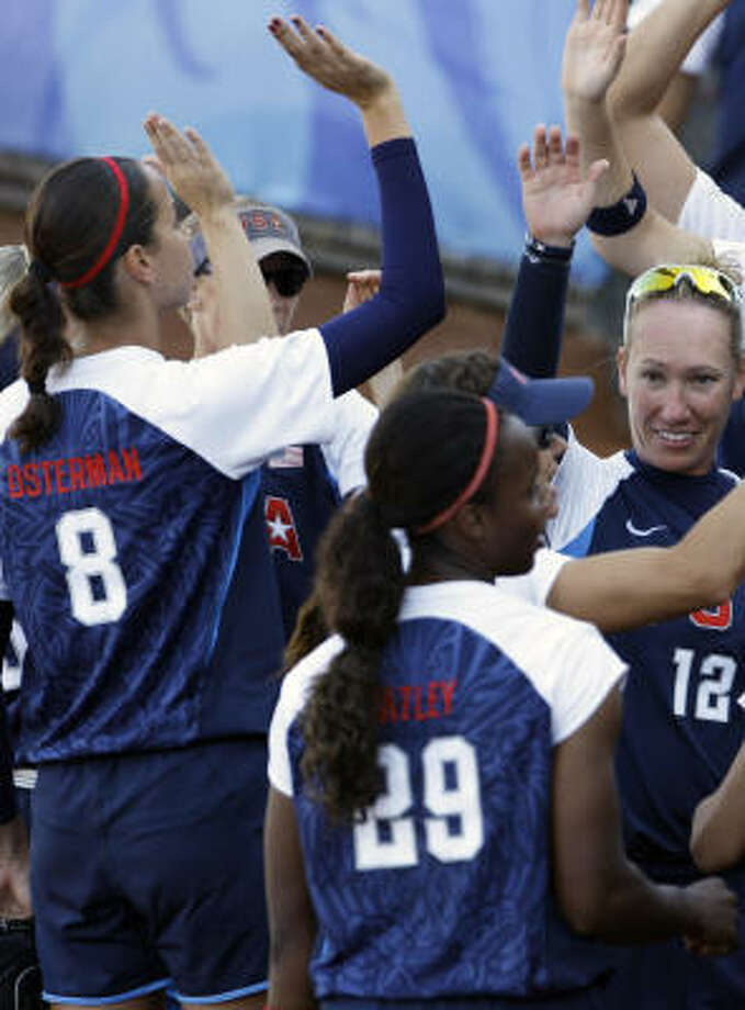 Cat Osterman (8) and the Americans let Canada take a 1-0 lead before firing things up. Photo: Elaine Thompson, AP