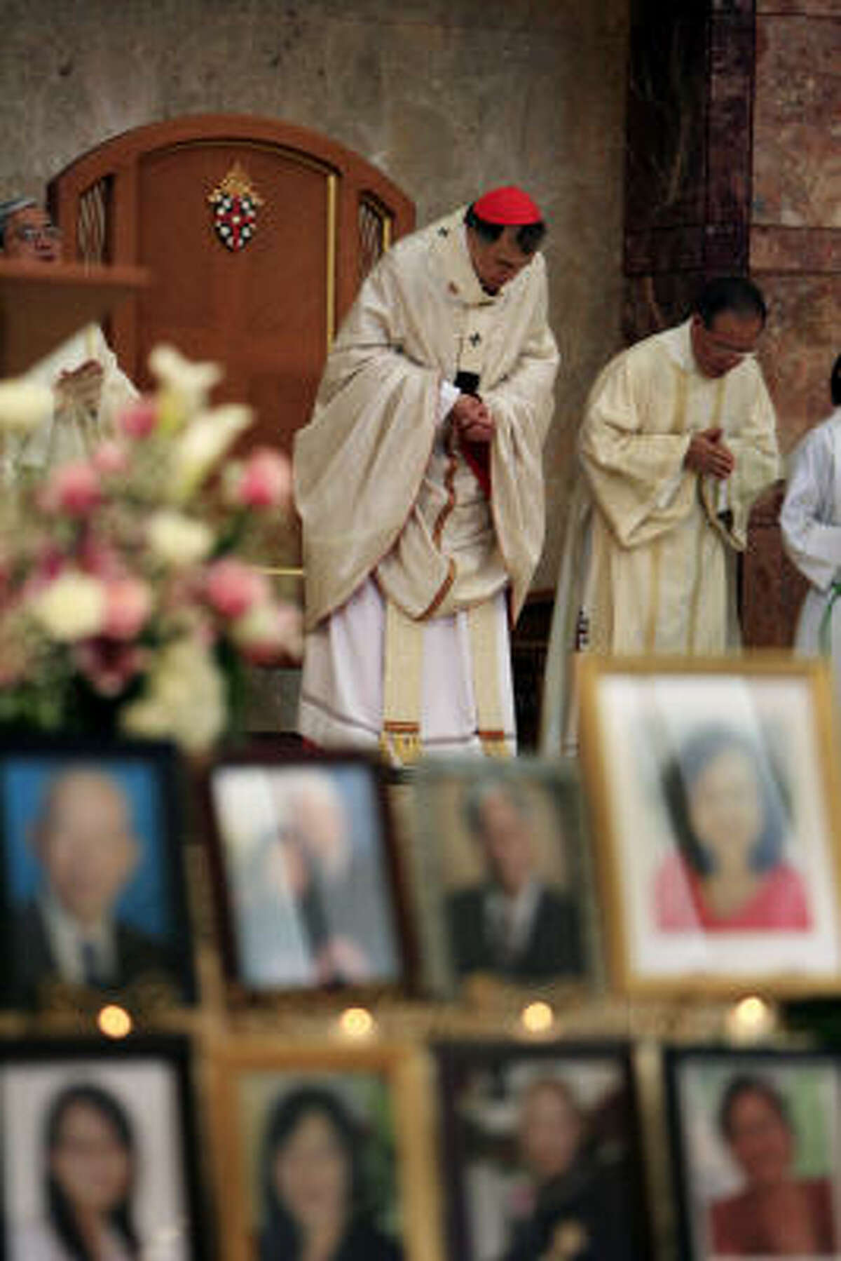 Cardinal Daniel N. DiNardo presides over a Mass on Sunday at the Co-Cathedral of the Sacred Heart that honored those who died in last month's bus crash in Sherman.