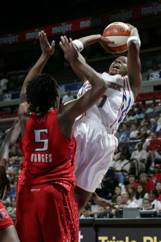 Two All-Stars were missing Tuesday for Detroit, which had Shannon Johnson take this shot over the Comets' Roneeka Hodges. Photo: JULIAN H. GONZALEZ, MCT