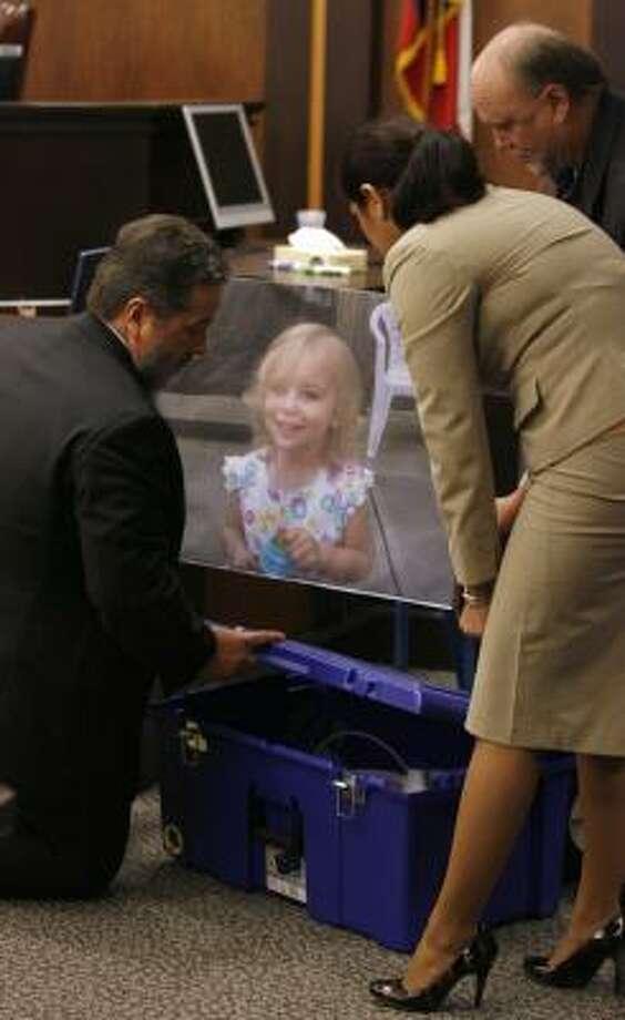 Prosecutors display Riley Ann Sawyers' photo above the box her body was found inside.  Photo: Jennifer Reynolds, Galveston Daily News