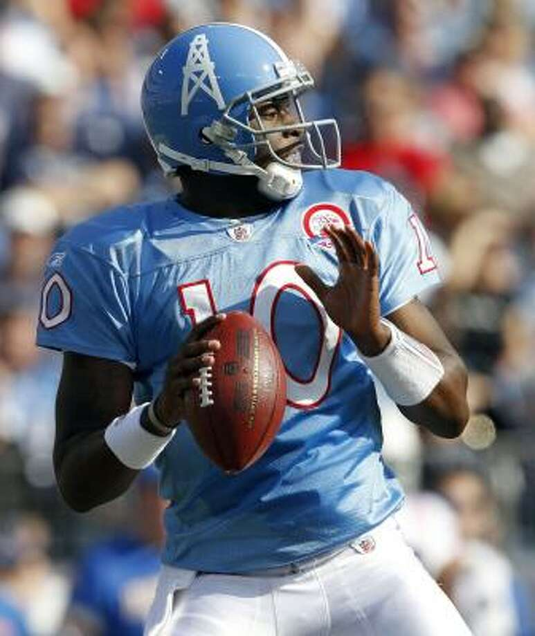 Vince Young, above, and running back Chris Johnson have sparked the Titans' recent resurgence. Photo: Wade Payne, AP