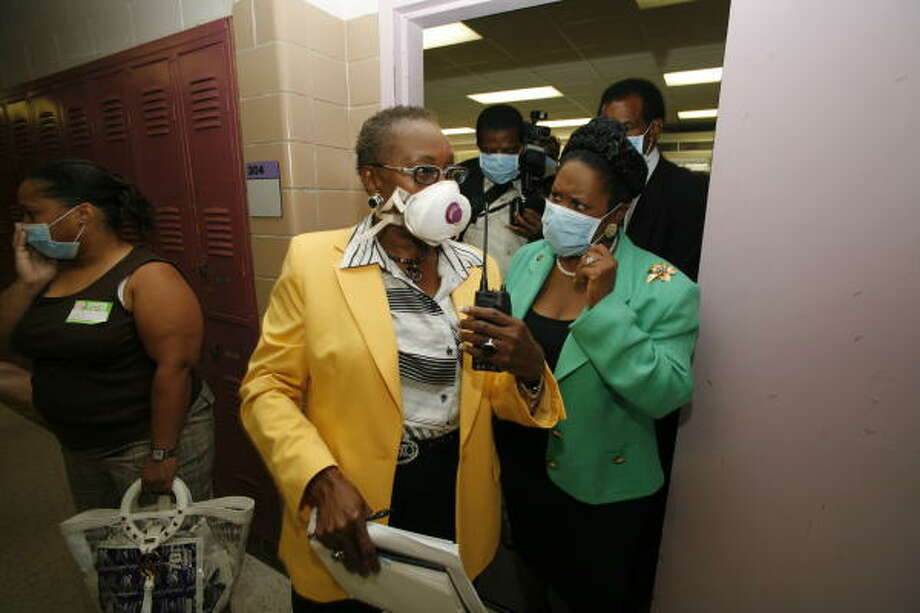 Key Middle School principal Mable Caleb, center,  and U.S. Rep. Sheila Jackson Lee, D-Houston, tour the campus on Monday with other officials. In recent weeks, several employees and students at the school have reported ailments. Photo: Steve Ueckert, Chronicle