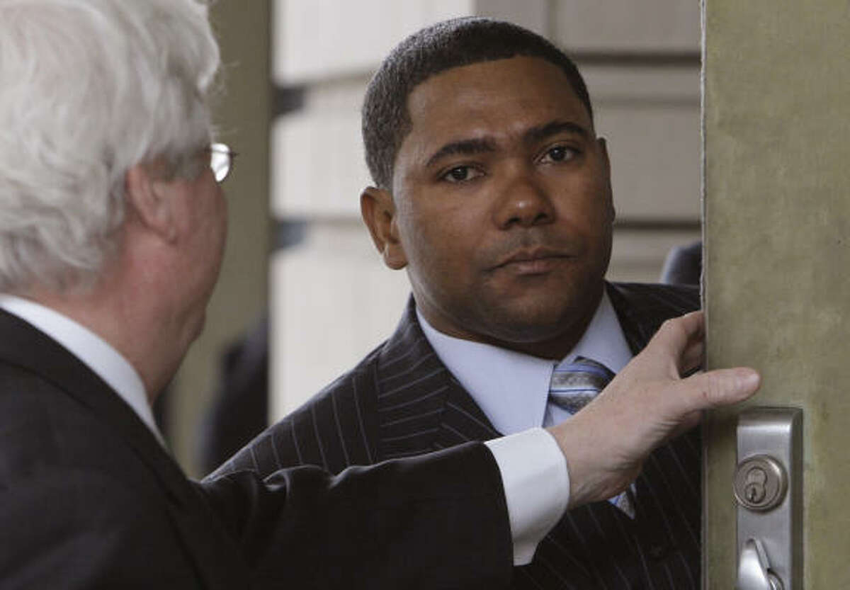 Astros shortstop Miguel Tejada enters U.S. District Court in Washington, where on Thursday he was sentenced to probation for making misrepresentations to Congress.