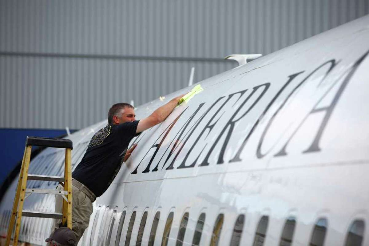 A worker polishes the fuselage as a detailing crew restores the shine to The Museum of Flight's Boeing VC137, a former Air Force One airplane at the museum's airpark. The plane, based on a Boeing 707, served as Air Force One for U.S. Presidents Eisenhower, Kennedy, Johnson and Nixon.