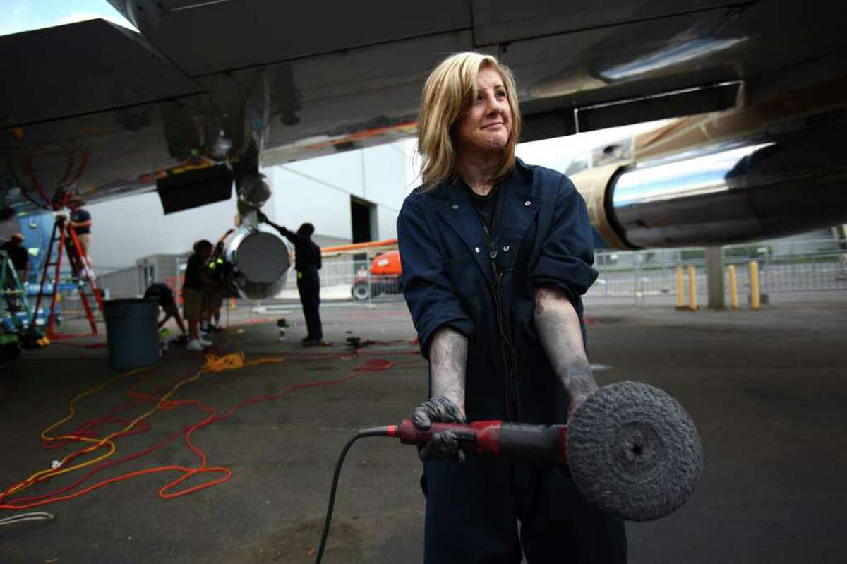 Ryan Doyle shows how dirty the job is as a detailing crew restores the shine to The Museum of Flight's Boeing VC137, a former Air Force One airplane at the museum's airpark.