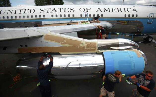 A detailing crew restores the shine to The Museum of Flight's Boeing VC137, a former Air Force One airplane at the museum's airpark on Tuesday, July 26, 2011. The plane, based on a Boeing 707, served as Air Force One for U.S. Presidents Eisenhower, Kennedy, Johnson and Nixon. Photo: JOSHUA TRUJILLO / SEATTLEPI.COM
