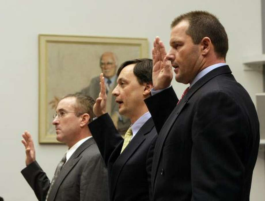 Former Astros pitcher Roger Clemens, right, lawyer Charles Scheeler center, and Clemens' former personal trainer Brian McNamee, are sworn in. Photo: Pablo Martinez Monsivais, AP
