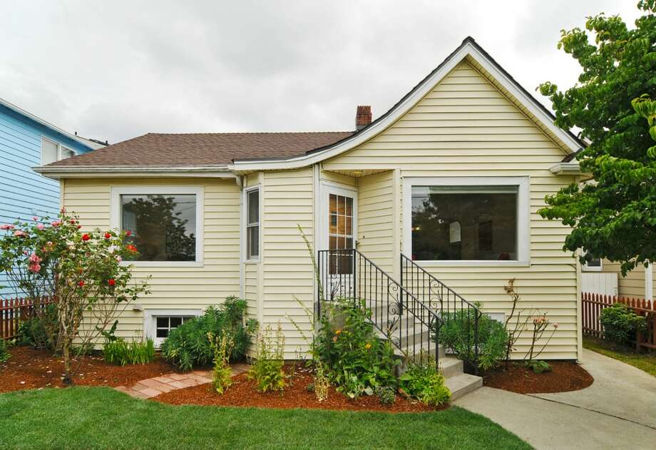 Beacon Hill offers quick access to downtown Seattle, views and nice, affordable houses. Here are a couple listed for around $300,000, starting with this house at 5522 20th Ave. S. The 1,620-square-foot house was built in 1930 and has three bedrooms, two bathrooms, arched doorways, crown moldings, built-ins, a lower level with a kitchenette and a garage/workshop. The house sits on a 4,000-square-foot lot and is listed for $310,000. (Listing: www.cbbain.com/Pages/PropertyDetail.aspx?ListingID=33193619) Photo: Coldwell Banker Bain