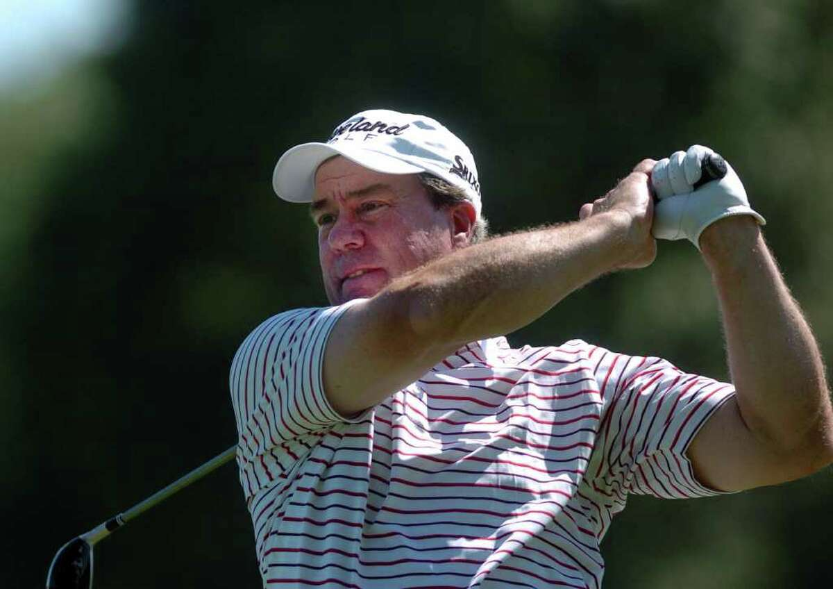 Gerard Courville tees off at the 14th hole during the 77th Connecticut Open at Brooklawn Country Club in Fairfield, Conn. Tuesday, July 26, 2011.