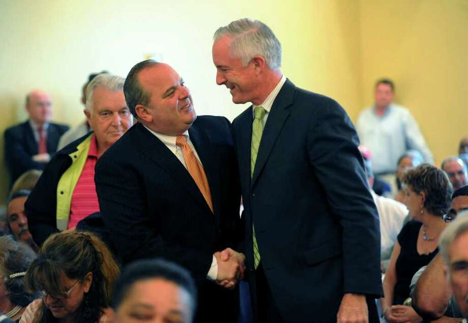 Former Mayor John Fabrizi , left, congratulates current Mayor Bill Finch after being nominated to run for mayor during a gathering of the Democratic Town Committee at Testo's Restaurant in Bridgeport, Conn. on Tuesday July 26, 2011. Photo: Christian Abraham / Connecticut Post