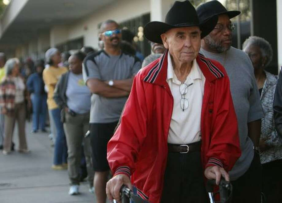 Richard Sexton, 82, waits with others Monday to cast their ballots at Palm Center on Houston's south side. Early voting in Harris County will continue through Oct. 31. Photo: MAYRA BELTRÁN, CHRONICLE