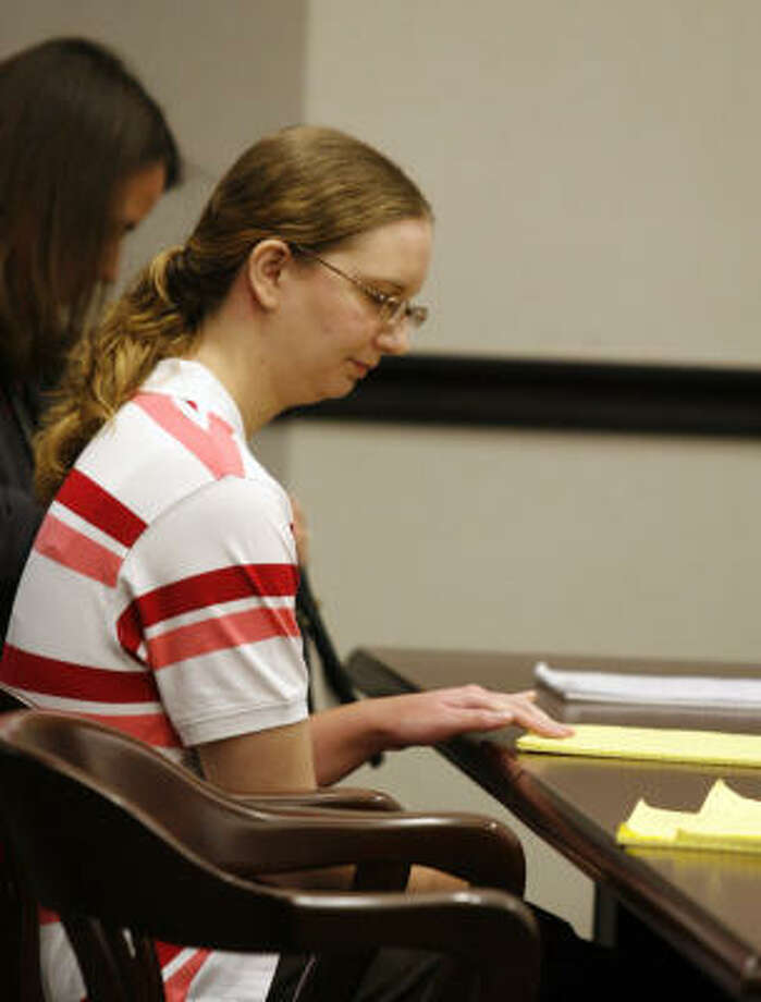 Kimberly Dawn Trenor, 20, who is accused of killing her daughter Riley Ann Sawyers waits for the second day of her trial to start in Galveston Wednesday. Photo: Jennifer Reynolds, AP