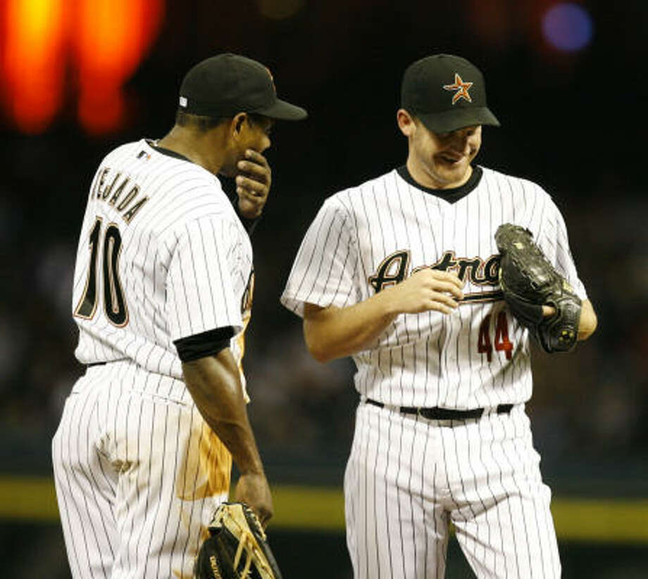"Roy Oswalt, right, says of Miguel Tejada: ""He's one of the best teammates I've had. He's a good guy to have in the clubhouse, brings energy on and off the field."" Photo: Nick De La Torre, Chronicle"