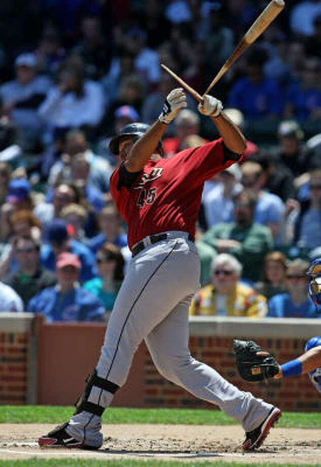 Carlos Lee breaks his bat on a single. Lee finished 3-for-4 at the plate. Photo: Jonathan Daniel, Getty Images
