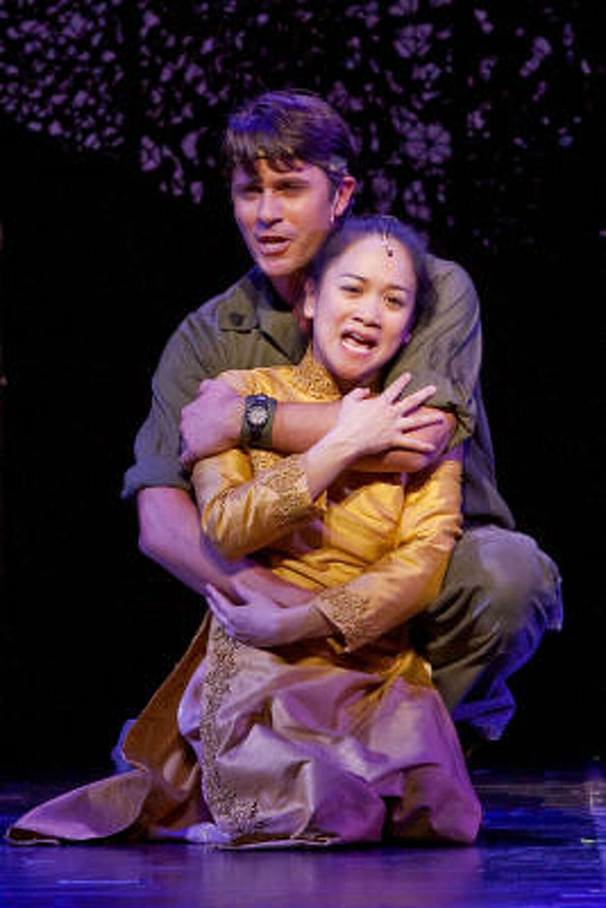 Melinda Chua and Eric Kunze take on the roles of Kim and Chris in Theatre Under The Stars' Miss Saigon, currently playing at Hobby Center.