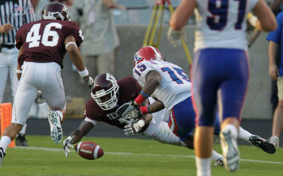 A&M cornerback Terrence Frederick (7) loses the ball on a punt return that was recovered by Louisiana Tech in the second quarter of Saturday's victory. Photo: Julio Cortez, Chronicle