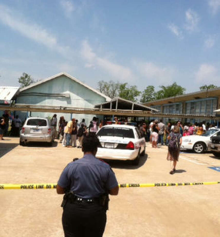 Police investigate the shooting at Ross Elementary school in north Houston. Photo: James Nielsen, Chronicle