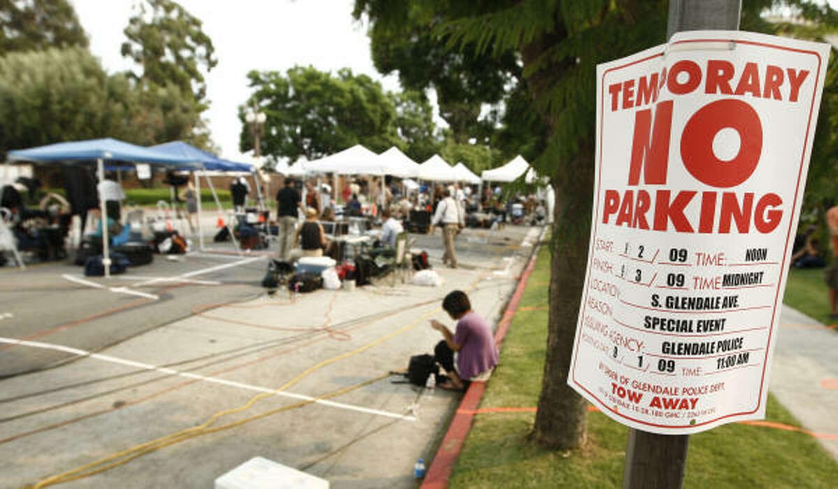 The media gather outside Forest Lawn Memorial Park in Glendale, Calif., on Thursday.